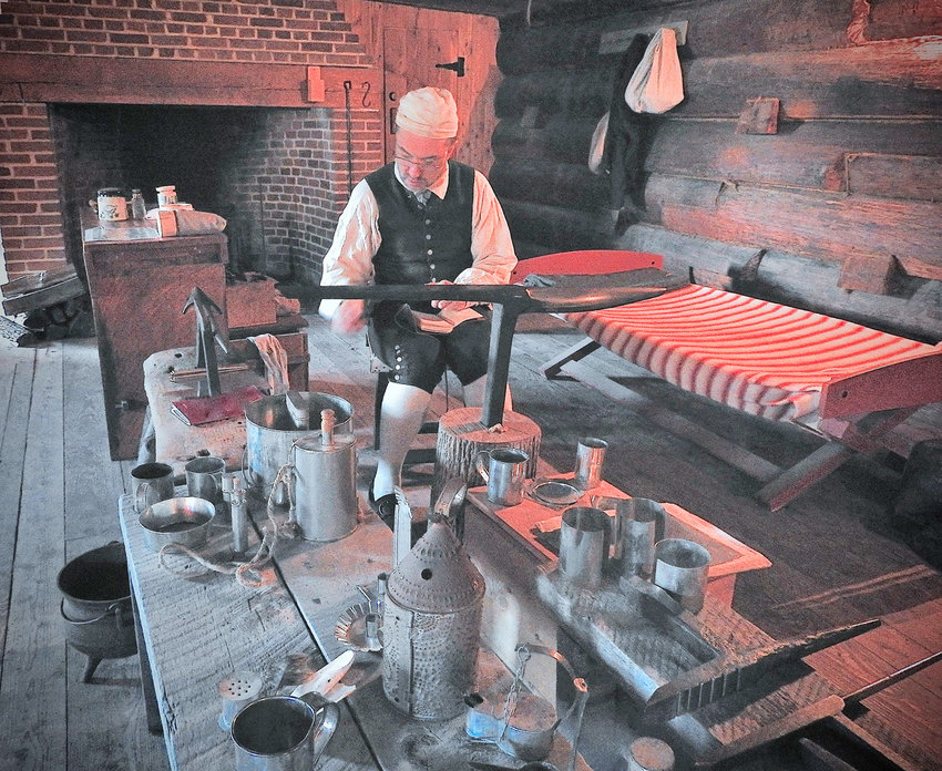 """DEMONSTRATING HIS CRAFT —A silversmith demonstrates how to make a lantern to park visitors. Fort Stanwix National Monument will host a1700s""""Artificers' Day"""" event on Saturday, June 15, from 9 a.m. to 4:30 p.m."""