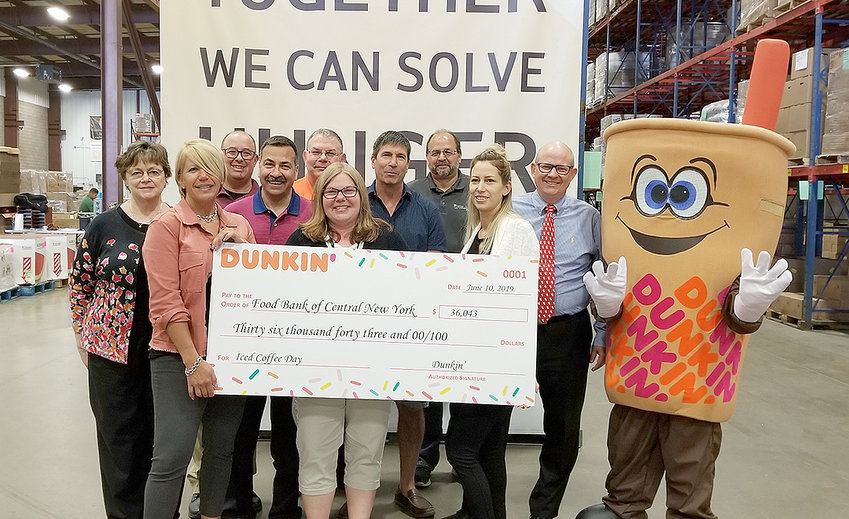 Dunkin' DONATION — Dunkin' representatives present a $36,000 donation to Food Bank of Central New York during an event at the food bank's headquarters in Syracuse on Monday, June 10. The donation is the result of Dunkin's recent Iced Coffee Day campaign during which Dunkin' franchisees donated $1 from every cup of Iced Coffee sold at participating Dunkin' restaurants in Central New York to the Food Bank. Iced Coffee Day has generated more than $186,000 for Central New York charities since 2012.