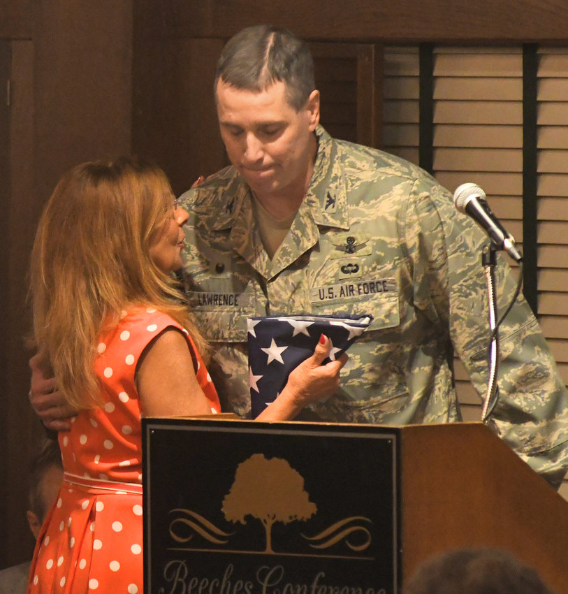 CHAMBER BUSINESS — Col. Timothy J. Lawrence of Rome Labs at Griffiss presents Jo Surace with a U.S. flag that once flew over Kabul, Afghanistan, for her husband Dennis at the 107th Annual Chamber of Commerce business meeting Friday morning. Dennis Surace, the meeting's honored guest, could not attend.