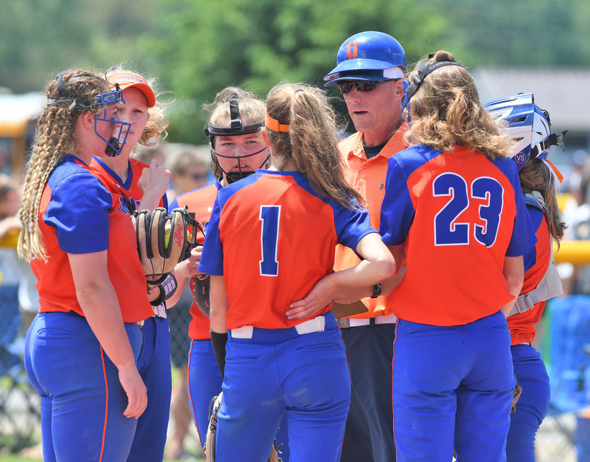 STRATEGY — Oneida softball head coach Mike Curro talks to the infielders during a time out against Eden Saturday morning. The Indians won 5-0 to advance to the Class B state finals later that day.