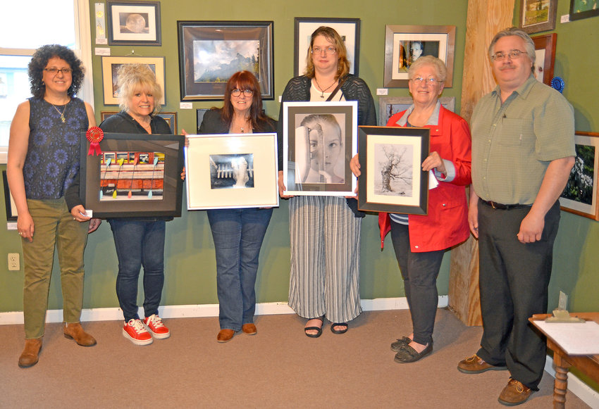 amateur photography contest — From left, Maria Ringlund, owner of The Photo Shoppe & Fusion Art Gallery; Olivia Bailey, Terry Ann DeLude; Lorraine Dowd; Sue Kiesel; Alan Ringlund, owner.
