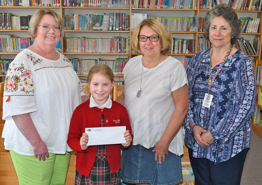 YOUNG SCHOLAR —Members of the Rome College Foundation and Rome Catholic School were on hand to present the 2019 Peter A. Fabrizio, Jr. Scholarship to RCS third-grader Luna Mathis.  Among those at Friday's ceremony were, from left: Nancy Wilson, RCS principal;  Mathis; Sue Caravelli, of the Rome College Foundation; and Barbara Swistak, RCS teacher.
