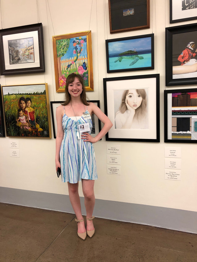 ON DISPLAY —Cassidy Matolka, of Whitesboro High School, poses with some of her artworks that were on display at the U.S. Capitol recently.  Matolka was the winner from New York's 22nd Congressional District in this year's annual district competition.