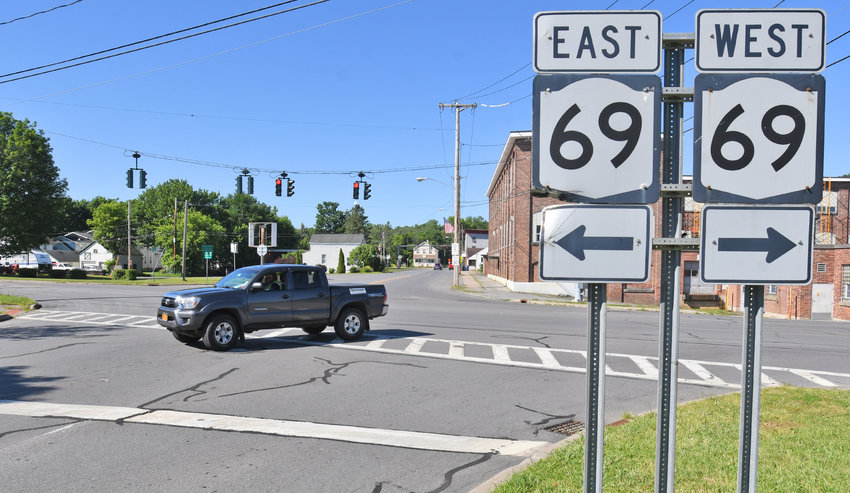 DON'T BLINK — The traffic light at the intersection of Route 69 and River Street will go from a blinking red and caution signal, to a three-colored, red, yellow and green light on Tuesday as construction begins on the Utica Street bridge. Village officials are considering permanently changing the light to a three-way signal.