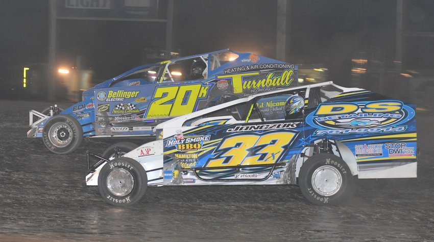 LATE PASS — Durhamville's Matt Janczuk in the No. 33x made a late pass on Kyle Inman No. 20K in lapped traffic and won the DIRTCAR sportsman series 30-lap feature race on Sunday, July 7 at Utica-Rome Speedway.