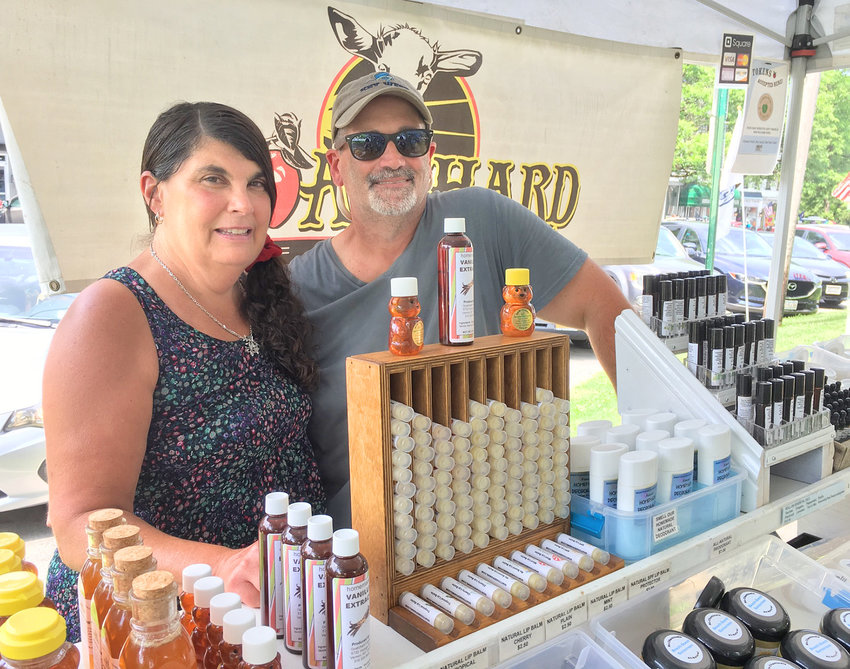 FRIENDLY FACES — J'nell and Tom Geer, owners of Goatchard Farms in Vernon Center, enjoy selling their homemade body products, as well as fresh, organic produce, at the Clinton Farmers Market.  They have been among the vendors at the market for seven seasons.