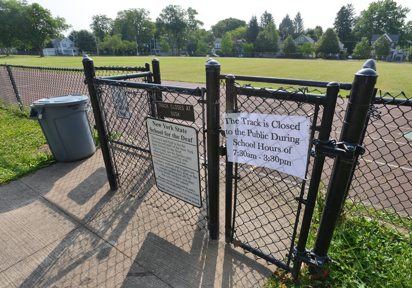 TRACKING THE SIGNS — The entrance to the track at the New York State School for the Deaf displays a notification restricting the track's usage by the public. The state Education Department said the change reflects concerns about some community members' behavior when using the site.