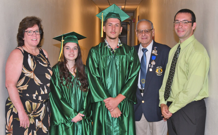NYSSD SCHOLARS — The Rome Lions Club recently awarded a pair of $500 scholarships to two graduating seniors, Abigail Anzalone and Alen Kendic, at the New York State School for the Deaf. Among those at the ceremony were, from left, NYSSD Superintendent Joyce Long;  Anzalone; Kendic; Joseph Defina, of the Rome Lions Club and a past district governor; and Chris Kimball, NYSSD guidance counselor.