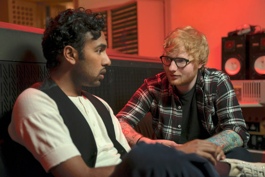 BIG BREAK — Jack Malik (Himesh Patel) gets a major career boost from Ed Sheeran (playing himself) after Jack begins performing songs by The Beatles, in Yesterday, directed by Danny Boyle.
