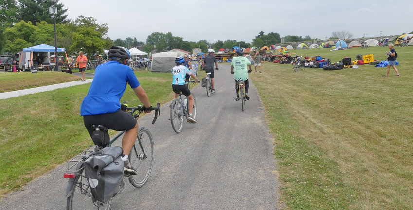 ROLLING INTO ROME — More than 650 cyclists camped out on the Fort Stanwix lawn Thursday as part of the eight-day Cycle the Erie Canal tour from Buffalo to Albany. Riders left for Canajoharie early today, after being served breakfast at the YMCA.