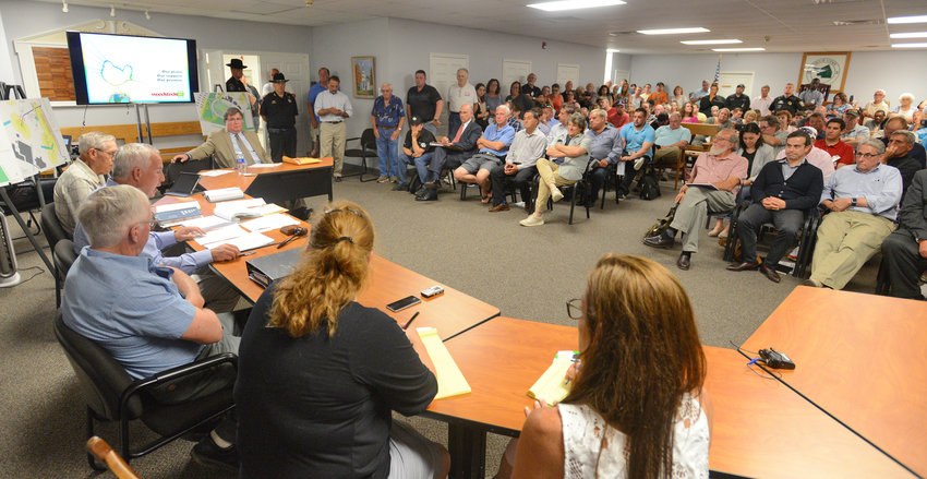 TAKING IT ALL IN — Residents, Woodstock 50 promoters and Vernon Downs employees meet with members of the Vernon Planning Board on Tuesday night. Members of the board upheld a denial of a permit for the event by the town code's department.