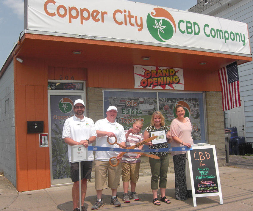 OPEN FOR BUSINESS — The owners of Copper City CBD Co. were joined by representatives of the Rome Area Chamber of Commerce last week for a ribbon-cutting ceremony at the 506 W. Thomas St. store. From left are: James Patterson and Joshua Sanfilippo, co-owners; Kage Sanfilippo;  Sue McLoughlin, of Berkshire Bank and chair of the chamber's Membership Committee, and co-owner Jessica Eaton. For store hours and additional information, call 315-281-8297 or go online to www.coppercitycbd.com.