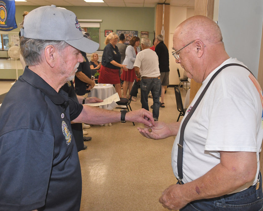 COMMEMORATED — Commemoration Committee member Larry Badger, left, places a lapel pin in the hand of Vietnam Veteran John Piccola Wednesday morning at the Copper City Community Center during the Vietnam Era Veterans Pinning Ceremony.
