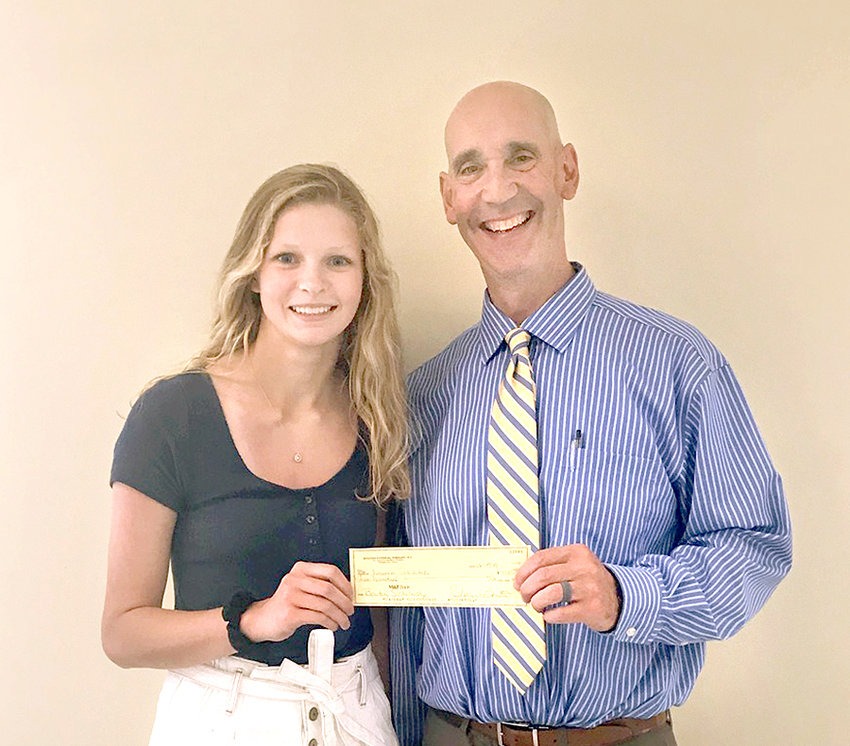 "SCHOLAR ATHLETE — Lauren Skibitski, a senior at Oneida High School, receives a $500 Bouton Physical Therapy scholarship from Chris Bouton during a recent ceremony. Skibitski, one of seven local student athletes from area schools nominated by athletic directors and recognized as ""Star Student  Athletes"" by Bouton Physical Therapy throughout the school year, will attend college and study pharmacology in the fall."