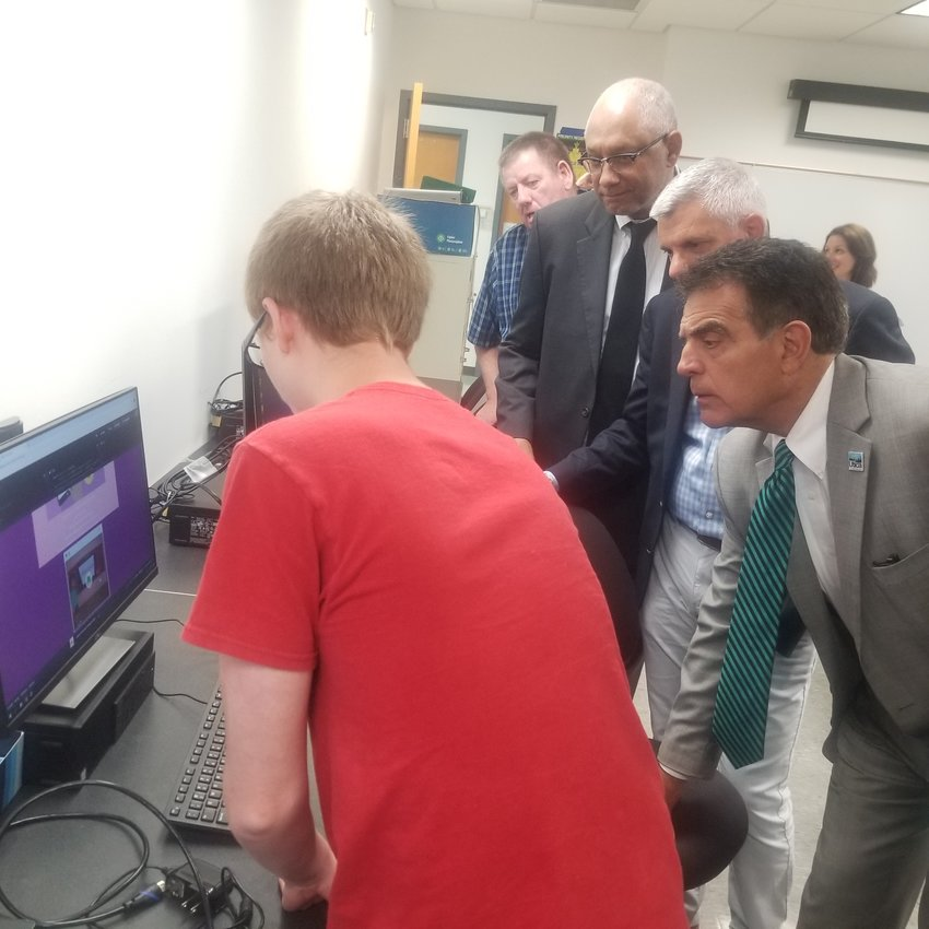 CHECK THIS OUT — A student at the AT&T Coding & Tech Camp held at MVCC's Utica Campus explains some of his work over the past two weeks to local officials who toured the camp on Friday.