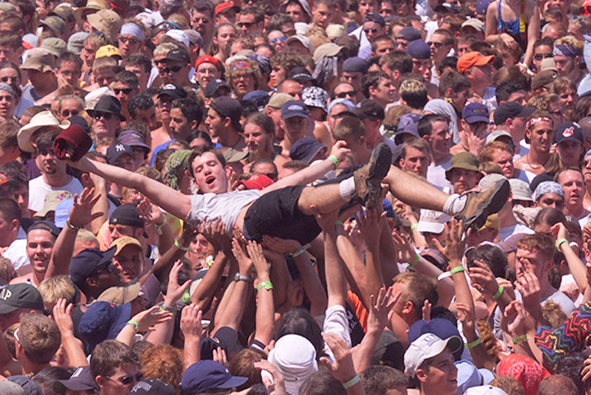 SURFING — Attendees of Woodstock '99 in Rome crowd-surfing during a performance.