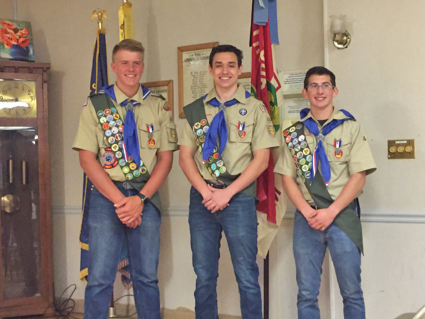 EAGLE SCOUTS — Members of Troop 44, from left, Ben Christensen, Collin Kelly and Michael Allogio, above, and fellow scout Hayden Johnson, left, receive their Eagle Scout pins during a recent ceremony. The troop is sponsored by the Clark Mills American Legion Post 26 and led by Scoutmaster Michael Dodson. The four completed the following Eagle projects: Construction of a Buddy Bench at Westmoreland School in memory of Logan Lints; building a safety enclosure for the grill area and a cement pad for Westmoreland Little League Field; construction of six new picnic tables for Westmoreland Town Park, and performing work at Fort Bull in Rome, including the cleaning up brush, cataloguing artifacts and updating the display for Rome Historical Society. All four of these Eagle Scouts are June graduates from Westmoreland High School.