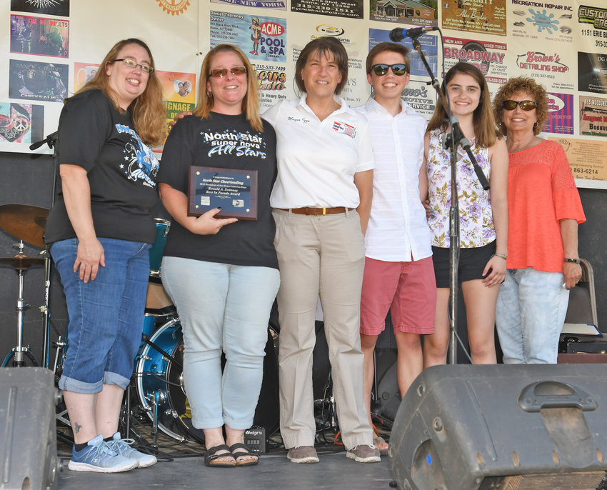 TOP ORGANIZATION —North Star Cheerleading took top place in the organization category for its entry in the annual Honor America Days Parade, receiving one of the Ronald A. Swinney Best in Parade awards. Above, Dawn Kippen, second from left, accepts the award from Mayor Jacqueline M. Izzo, center, and members of the Swinney family.