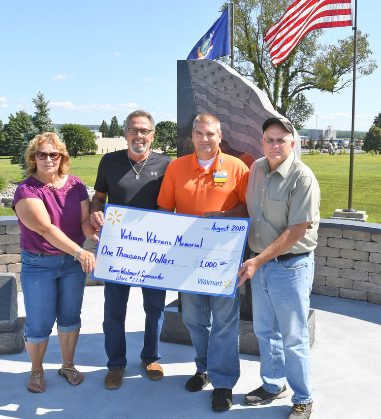SUPPORT FOR VETS MEMORIAL — On Thursday, Walmart donated $1,000 toward the Vietnam Veterans Memorial located at Griffiss Park. Funds will be used for care of the memorial and future improvements. From left: Sophie Jennings; Rick Falcone, president of the state Veitnam Veterans Memorial Fund; Rome Walmart Manager Jamie Butler; and Mark Jennings, associate member of the Vietnam Memorial Committee.