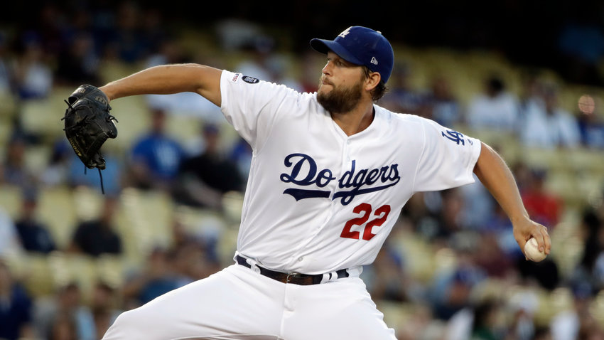 MOVES PAST KOUFAX — Dodgers starting pitcher Clayton Kershaw throws to a Blue Jays batter during Tuesday's game in Los Angeles.  Kershaw got the win to pass Sandy Koufax for most wins by a Dodgers left-hander as Los Angeles rolled to a 16-3 win.