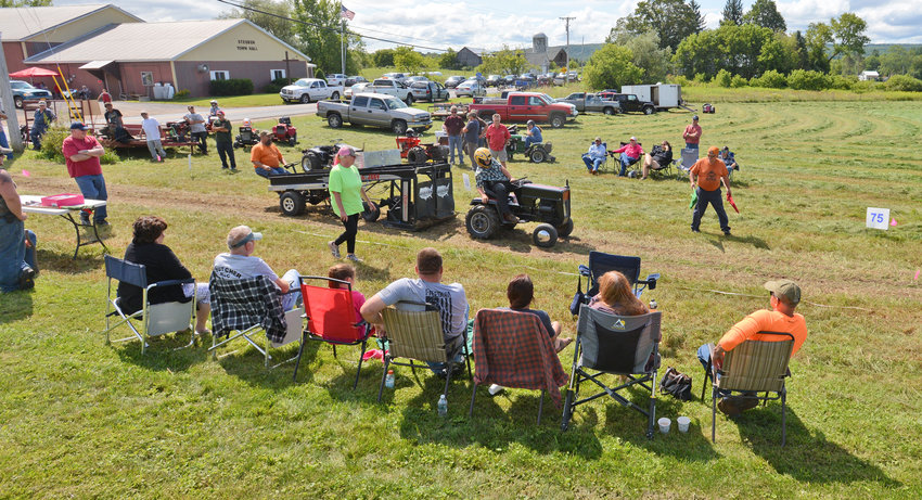 ONE, TWO THREE, PULL! — Reece Synakowski puts the pedal to the metal during the lawnmower tractor pull competition at the Steuben Old Home Days on Saturday. Hundreds of visitors gathered for events ranging from the tractor pull to an auction to a cornhole tournament.