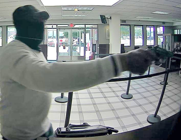 BANK ROBBER SOUGHT —A male bank robber wearing a mask and brandishing a handgun is wanted for knocking over the Key Bank on Utica's east side Monday afternoon. Anyone with information is asked to call Utica Police at 315-360-1985 or 315-223-3510.