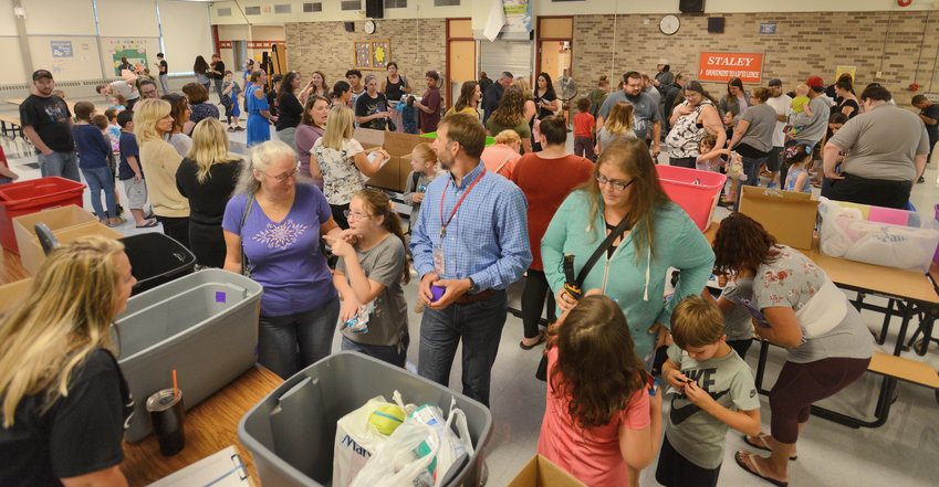 """STALEY MEETING AND GREETING — A large gathering of families took part in Staley Elementary School's """"Meet and Greet"""" session Wednesday night in the school cafeteria. Visitors got a chance to drop off supplies early and meet the school's new principal. Classes begin Sept. 5."""