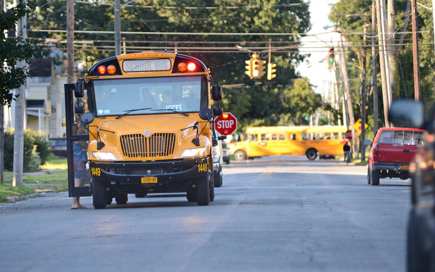 SCHOOL BUSES COMING SOON — A Birnie company school bus stops on North Madison Street in this file photo. The first day of classes for the 2019-20 school year is Sept. 5. A new Here Comes the Bus mobile application will enable parents to track their children's school buses.