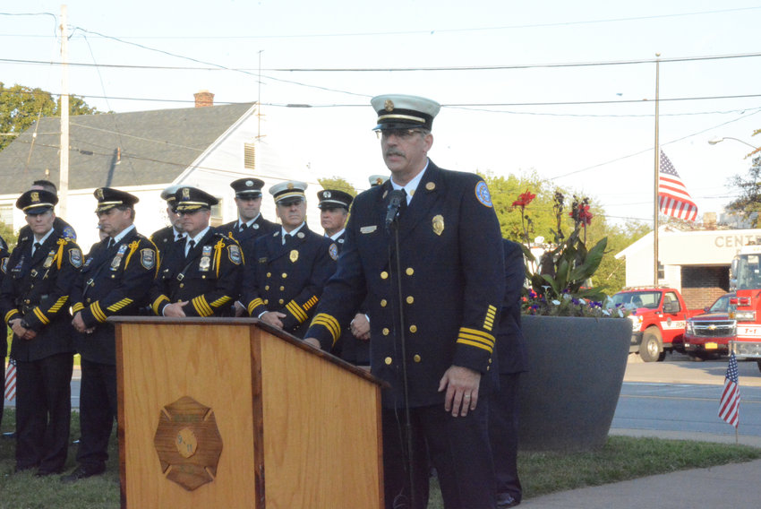 NEVER FORGET—Rome Fire Department Deputy Chief Mark S. Kohlbrenner speaks during the 9/11 Remembrance and Wall of Honor Dedication on at the Rome Police & Fire Memorial Park on Black River Boulevard, across from the Central Station, on Wednesday, Sept. 11.