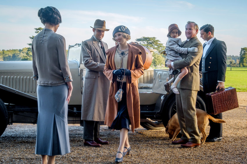 """RETURN TO DOWNTON — Elizabeth McGovern, from left, Harry Hadden-Paton, Laura Carmichael, Hugh Bonneville and Michael Fox, right, in a scene from """"Downton Abbey,"""" in theaters on Sept. 20."""