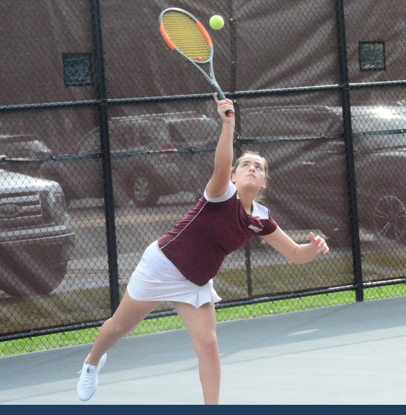 SERVE AND VOLLEY — Clinton freshman tennis player Sabina Rodriguez-Plate smashes a serve across the net in a match against Vernon-Verona-Sherrill on Tuesday, Sept. 10 at the Clinton Central School tennis courts.