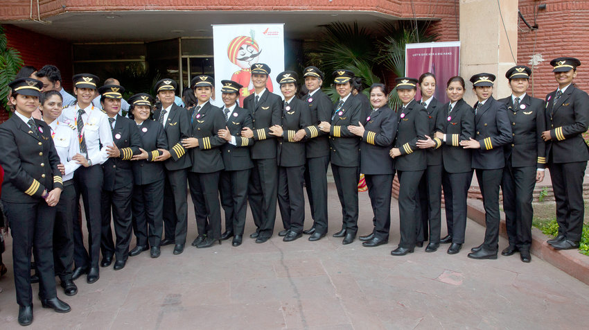 NEW MENU — Female pilots of Air India, the country's state-owned carrier, pose for a photograph after a ceremony on the eve of international women's day, in New Delhi, India.  Air India is putting its crews on a diet, changing their inflight menu to special low-fat meals.