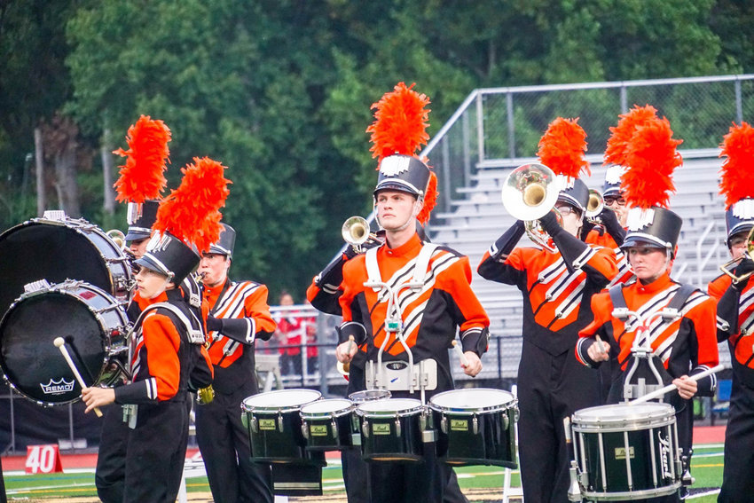 KEEPING THE BEAT — From left in front, Rome Free Academy marching band members Kyle Brement, Patrick O'Neil, and Lexie Lennon perform at a competition last weekend in Old Tappan, N.J. The RFA Marching Black Knights will perform again Friday night at the RFA football game at RFA Stadium.