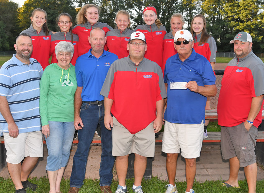 HELPING LOCAL YOUTH — Members of the Steve Obrist Memorial Golf Tournament committee presented a check for $1,000 to the members of the Rome Spirit girls softeball organization on Wednesday in a ceremony at Kost Field.  In total, the Obrist committee has donated $14,000 to local youth sports. From left, front row: Jim Johnson, Mary Johnson and A.J. Johnson, all of the Obrist tournament committee; Jerry Closinski, of the Rome Spirit; Tom Burch, tournament founder and committee member; and Mark Beer, of the Rome Spirit. Back row: Rome Spirit players Adriana Varano, Autumn Millington, Shea Larkin, Laina Beer, Kelly O'Neill, Maggie Cummings and Maggie Closinski.