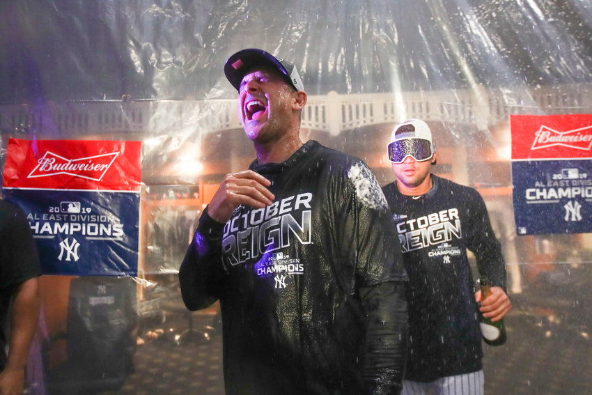 BEASTS OF THE AL EAST — Yankees manager Aaron Boone celebrates after defeating the Angels on Thursday in New York. The Yankees clinched the AL East title for the first time since 2012 with their 100th win of the year.