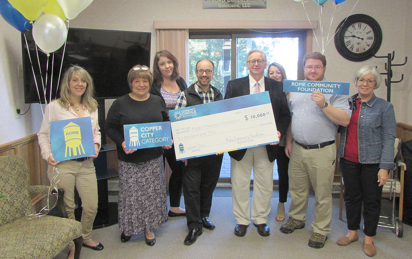 SURPISE! — Members of the Project Fibonacci Foundation, including Project Fibonacci founder Andy Drozd, accepts a $10,000 grant for being the Copper City category winner in the The Community Foundation of Herkimer and Oneida County's second annual Community Choice Awards contest.