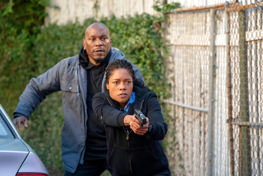 """This image released by Sony Pictures shows Naomie Harris, left, and Tyrese Gibson in a scene from """"Black and Blue,"""" in theaters on Oct. 25. (Alan Markfield/Sony Pictures via AP)"""
