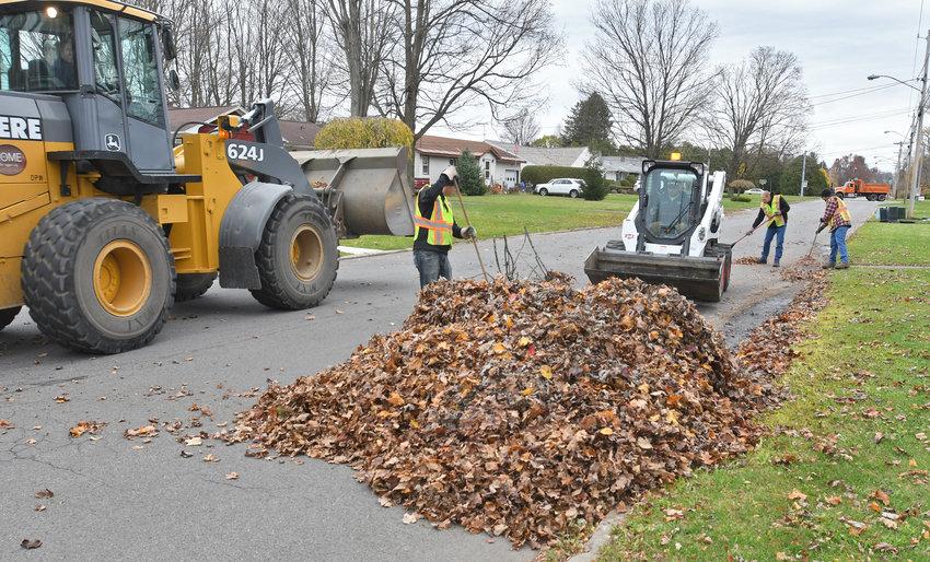 City crews pickup leaves on North Madison St.
