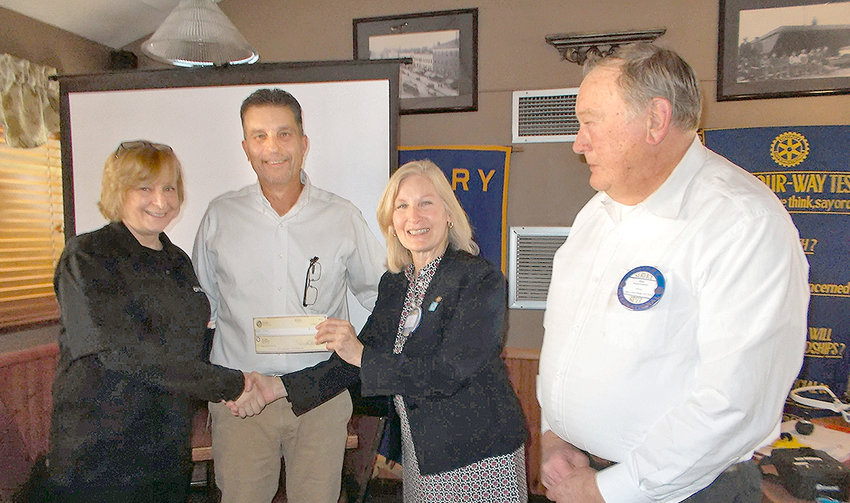 FLIGHT SUPPORT —The Rome Rotary Club presents a check for $500 to the CNY Drone organization at the Oct. 29 meeting to carry on their drone focused STEM education work. From left: Lisa Marie Payne, administrator of CNY Drones with her husband Bob; Rome Rotary Club President Nancy Neiley; and Rotary Club Past President Donald Schlueter, who introduced CNY Drone to the Rome Community at the 2019 Canalfest.