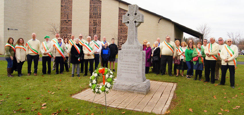 """HONORING ANCESTORS —Members of the Men's Ancient Order of Hibernians of Oneida County and the Ladies of Knock LAOH gather at the Irish """"Great Hunger"""" Memorial (in Gaelic """"An Gorta Mor"""") at Our Lady of Lourdes Church in Utica on Sunday. The annual Great Hunger Memorial Mass, sponsored by the AOH, honors millions of Irish who died of starvation in the 1840s as a combination of potato blight and British appropriation of other agricultural products including livestock"""