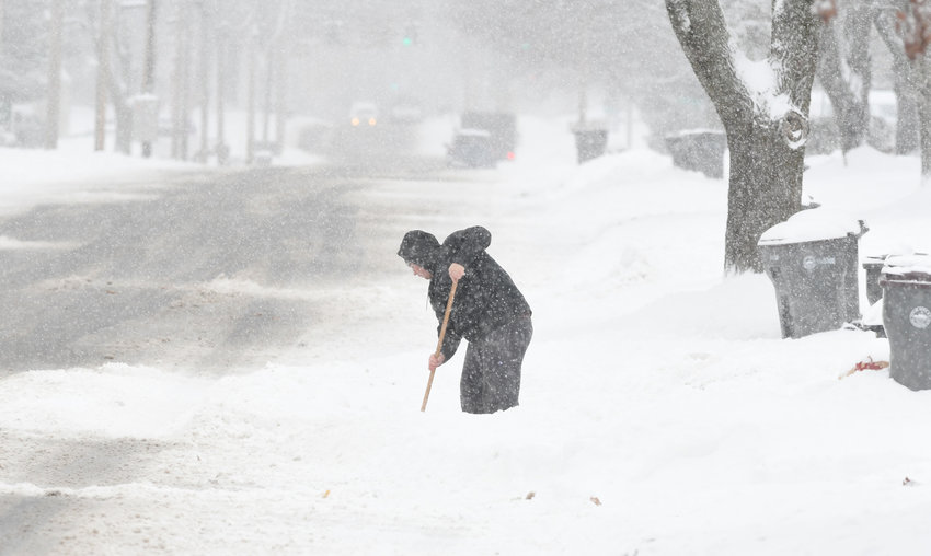 LONESOME SHOVELER — A lone man is pictured shoveling on West Bloomfield Street during a winter storm last winter.