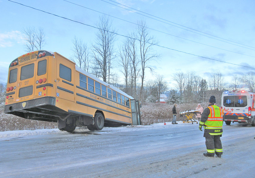 NO INJURIES —City fire officials said no one was injured when this Birnie Bus spun into a ditch on the side of Oswego Road this morning, just before the intersection with Route 46. Officials said three students, the bus monitor and the bus driver escaped injury when the bus spun nearly 180-degrees on the snow and ice-covered roadway at about 7 a.m. The Sheriff's Office is investigating.
