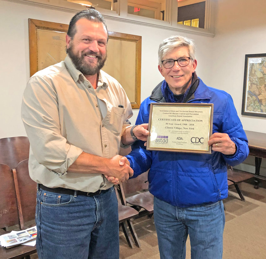 GOOD WATER — Village of Clinton Mayor Steven J. Bellona presents a Certificate of Appreciation to DPW Superintendent Robert Rockwell from the American Dental Association for keeping the water of Clinton fluoridated for the past 50 years. The presentation was made on Monday, Nov. 4 at Lumbard Hall during the regular monthly meeting.