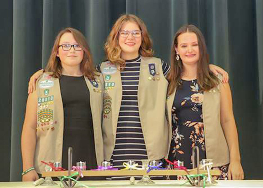 "SILVER AWARD — Westmoreland Girl Scouts Caitlyn Merritt, Bailey Metzger and Allison Davis were awarded the Girl Scout Silver Award for collecting clothes and establishing a special ""black-and-white attire"" closet for Westmoreland Junior/Senior High School choir and band members."