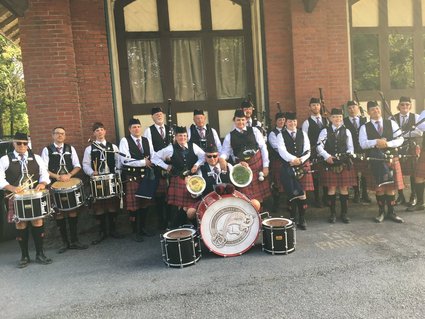 LOOKING FOR COMPANY — Members of the Mohawk Valley Frasers pose for a photo after a recent event.  The the band is always on the lookout for new members who wish to cultivate their taste for Celtic music, group officials said, adding that age is no barrier to learning the pipes or drums. The band offers extensive instruction to all who would like to learn, according to group officials.