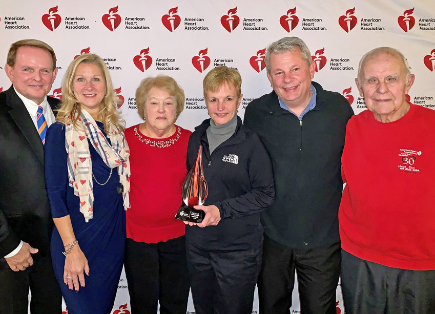 Presentation of the Torch of Strength Award — From left, Albert Pylinski, Liz Campbell, Dorothy Sperbeck Cornnell, Theresa Swider, Dan Swider, Allan Cornnell.