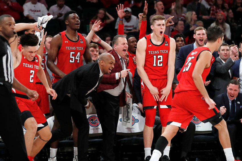 ANOTHER NO. 1 FALLS — Texas Tech players whoop it on on the sideline late in Tuesday's 70-57 win over top-ranked Louisville in the Jimmy V Classic at Madison Square Garden. Pictured from left are Louisville players Clarence Nadolny, Russel Tchewa, Terrence Shannon Jr. and Davide Moretti.