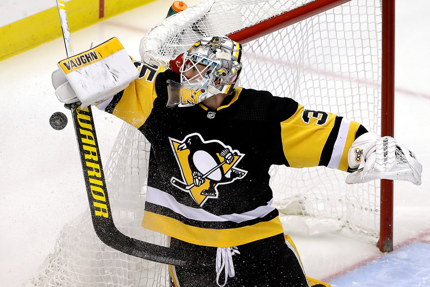 SHUTOUT STREAK ENDS — Penguins goaltender Tristan Jarry stops a shot during the first period of Tuesday's game against the Canadiens in Pittsburgh. Jarry's franchise-record shutout run ended at 177 minutes, 15 seconds as Montreal scored a 4-1 win.