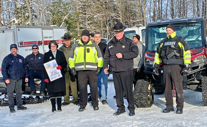 SNOWMOBILE WARNING —Oneida County Sheriff Robert M. Maciol, center, was joined by local politicians, law enforcers, rescue personnel and snowmobile riders to give his annual snowmobile safety announcement in Remsen Thursday afternoon.
