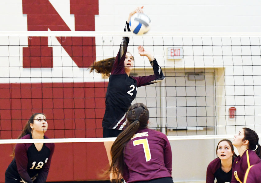 SPIKE — Clinton senior Sarah Martini (18) looks on as junior Kali Peck (2) slams a kill over the net in front of Canastota senior Sierra Tucci (7) during the CSC girls volleyball matchup on Friday, Dec. 20 in Clinton. Canastota beat the Warriors 3-0.